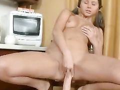 Brunette Teen Loves Playing With Her Long Dildo