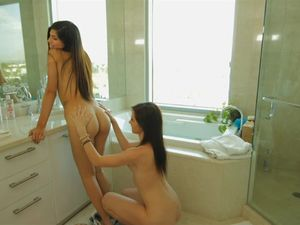 Two Lovely Brunette Teens Sharing A Stiff Long Rod